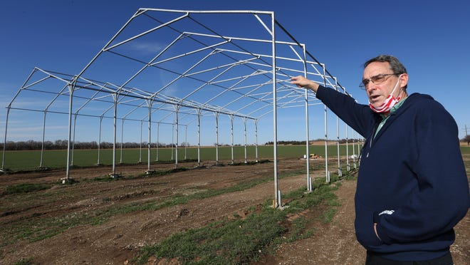 David Hinson, president of TSO Greenhouses, talks about the greenhouse facility being constructed on land north of Marquette.