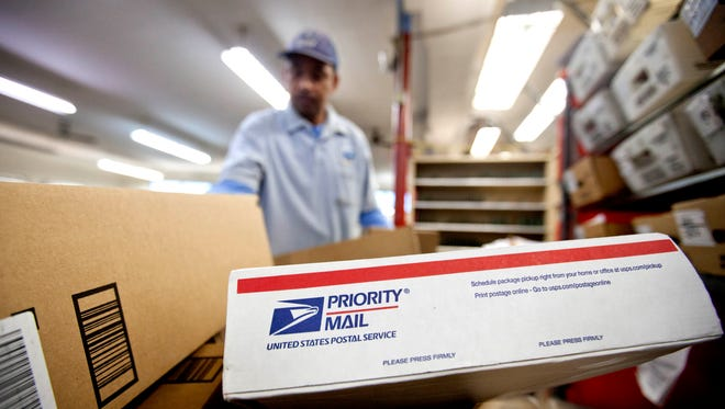 Packages wait to be sorted in a Post Office in Atlanta. Regulators on Dec. 24, 2013, approved a price hike of 3 cents for a first-class stamp, bringing the charge to 49 cents a letter in an effort to help the Postal Service recover from severe mail decreases brought on after the 2008 economic downturn.