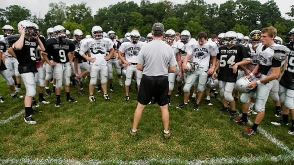 South Western coach Don Seidenstricker talks with his team during practice Monday.