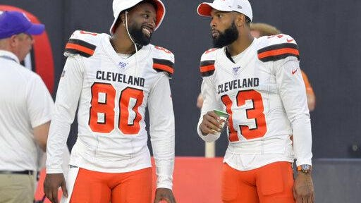 Browns wide receivers Jarvis Landry (80) and Odell Beckham Jr. talk on the sideline during a preseason game in August.