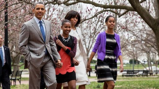 President Barack Obama and his family walk to  Easter Sunday services at St John's Episcopal Church in Washington, D.C.,  on March 31, 2013. With him are, from left, daughter Sasha, first lady Michelle Obama and daughter Malia.