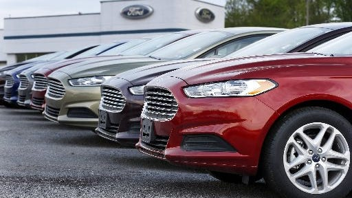 A row of new 2013 Ford Fusions are displayed at a dealership in Zelienople, Pa., on May 8, 2013. That model year of Fusions are included in a new recall.