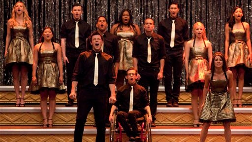 "In this 2010 publicity file image released by Fox, the cast of ""Glee,"" front row from left, Cory Monteith, Kevin McHale and Lea Michele, center row from left, Jenna Ushkowitz, Dijon Talton, Mark Salling and Dianna Agron, back row from left, Heather Morris, Chris Colfer, Amber Riley, Harry Shum Jr. and Naya Rivera perform ""Don't Stop Believing"" in the season finale episode of the series which aired on June 8, 2010. Glum news for ""Glee"" ? Britain's High Court on Friday, July 18, 2014 says the musical TV show must change its name because it breaches the trademark of a chain of comedy clubs. A judge has told Twentieth Century Fox that it must re-name the series in Britain, though the order won't take effect until an appeal has been heard."