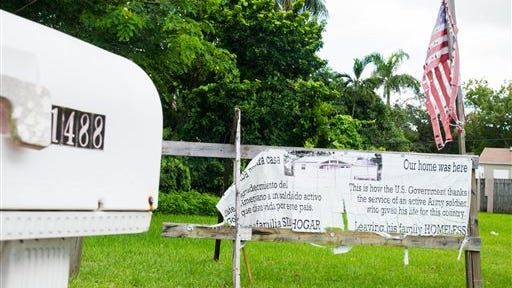This photo shows a sign where a home was in Miami. A federal judge has slammed Miami-Dade County for refusing to delay demolition of a soldier's home while he trained in California. The house was reportedly razed in 2011 after U.S. Army Staff Sergeant Jesus Jimenez did not heed numerous county requests to fix building code violations.