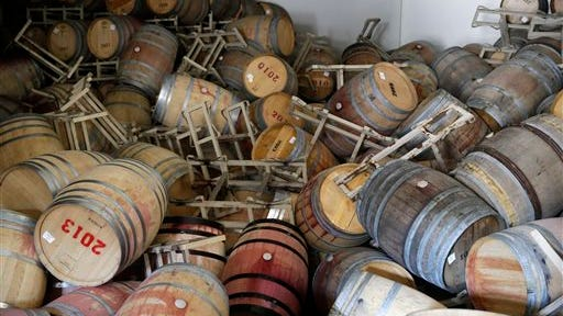 Barrels filled with Cabernet Sauvignon are toppled on one another following an earthquake at the B.R. Cohn Winery barrel storage facility Sunday in Napa, Calif. Winemakers in California'?s storied Napa Valley woke up to thousands of broken bottles, barrels and gallons of ruined wine as a result of Sunday?s earthquake.