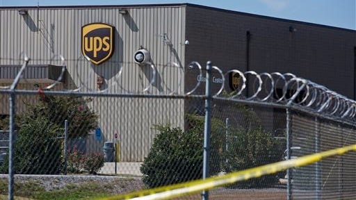 A UPS warehouse is surrounded by police tape after a shooting Tuesday, Sept. 23, 2014, in Birmingham, Ala. A UPS employee opened fire Tuesday morning inside one of the company's warehouses in Alabama, killing two people before taking his own life, police said. (AP Photo/Brynn Anderson)