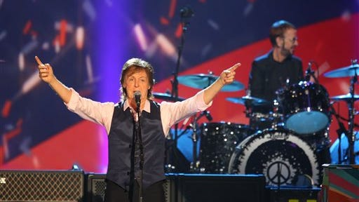 FILE - In this Jan. 27, 2014 file photo, Paul McCartney and Ringo Starr perform at The Night that Changed America: A Grammy Salute to the Beatles,  in Los Angeles.