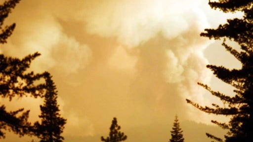 This image provided Aug. 11, 2012 by Chips Fire shows a wildfire inside Northern California's Plumas National Forest. Strong winds and low humidity have helped this wildfire increase to nearly 47 square miles.
