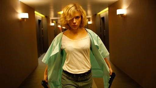 """This image released by Universal Pictures shows Scarlett Johansson in a scene from """"Lucy."""" (AP Photo/Universal Pictures, Jessica Forde)"""