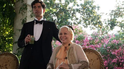 """This photo released by courtesy of Sony Pictures Classics shows, Hamish Linklater, left, as Brice and Jacki Weaver as Grace, in a scene from the film, """"Magic in the Moonlight,"""" directed by Woody Allen."""