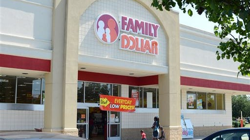 In this Tuesday, July 29, 2014 photo,  customers enter a Family Dollar store on Plaza Boulevard, in Kinston, N.C. There?s now a bidding war for Family Dollar, with Dollar General offering about $9.7 billion for the discounter in an effort to trump Dollar Tree?s bid of $8.5 billion. (AP Photo/Kinston Free Press, Janet S. Carter)