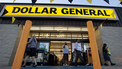 FILE - In this Wednesday, Sept. 25, 2013, file photo, customers exit a Dollar General store, in San Antonio. There?s now a bidding war for Family Dollar, with Dollar General offering about $9.7 billion for the discounter in an effort to trump Dollar Tree?s bid of $8.5 billion. (AP Photo/Eric Gay, File)
