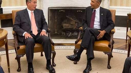President Barack Obama talks with House Speaker John Boehner of Ohio in the Oval Office of the White House in Washington, Tuesday, Sept. 9, 2014. The president met with Congressional leaders to discuss options for combating the Islamic State. (AP Photo/Evan Vucci)