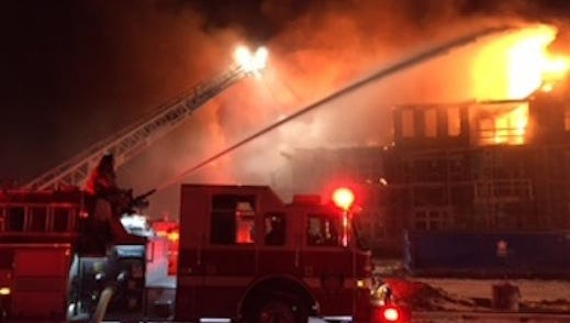Firefighters battle a blaze at The Flats of Fishers Marketplace.
