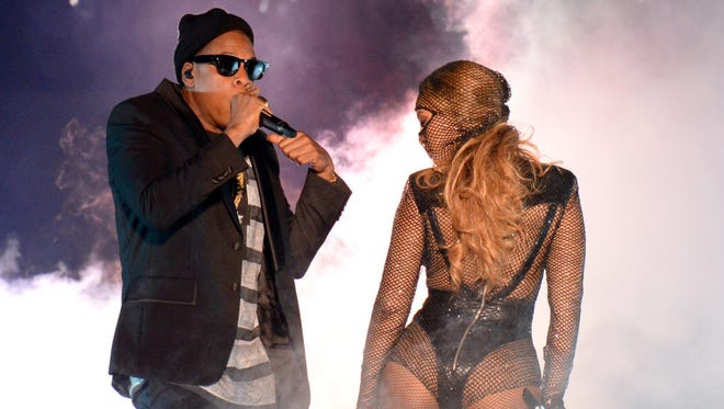 """Jay Z and Beyonce perform during opening night of the """"On The Run Tour: Beyonce And Jay Z"""" at Sun Life Stadium on June 25, 2014, in Miami Gardens, Florida."""