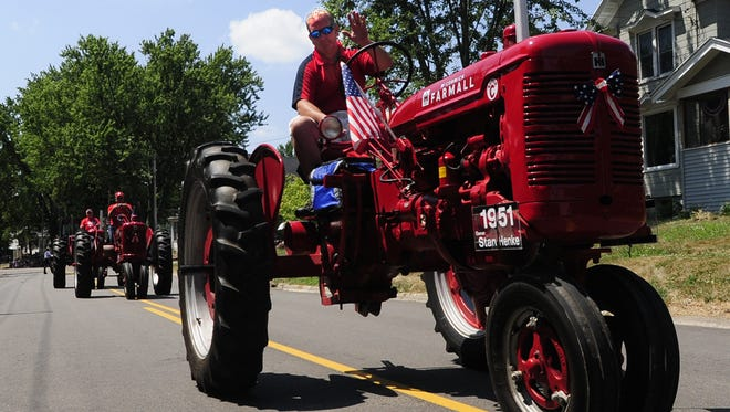 Mike Henke of Oshkosh rides his family's vintage tractor in Eldorado's annual parade. Such uses would be allowed under the provision added to the state budget.
