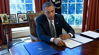 President Obama signs a Memorandum of Disapproval Regarding S.J. Res. 8, a Joint Resolution providing for congressional disapproval of the rule submitted by the National Labor Relations Board relating to representation case procedures, on Tuesday in the Oval Office.