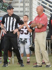 Parkway head coach David Feaster chats with a referee