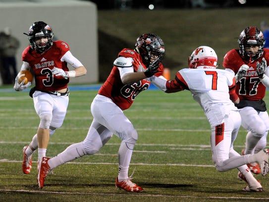 Iraan running back Kyle O'Bannon runs through the line