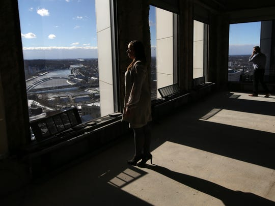 Lauren Gallina of Gallina Development Corp. looks south from the 17th floor of the former Chase Tower now The Metropolitan.