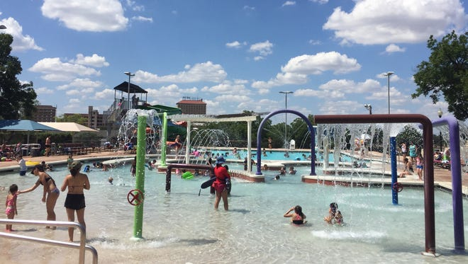 Residents play in the shallow end of San Angelo's Love Municipal Pool on June 20, 2017.