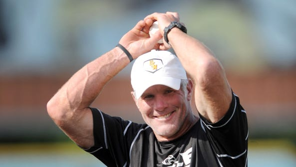 Brett Favre, who threw out the first pitch before a