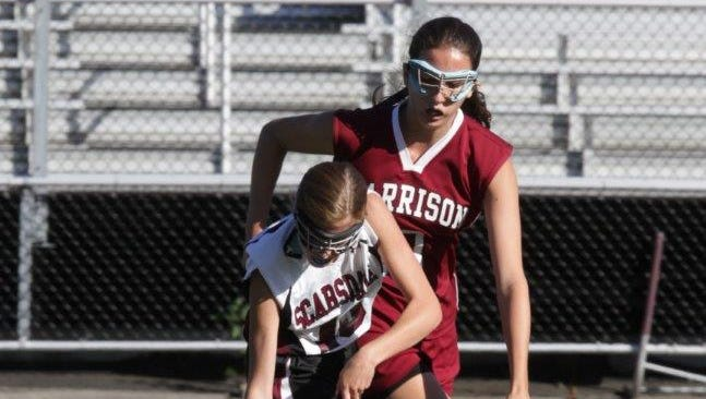 Harrison's Grace Manning tries to steal the ball from Scarsdale's Jilly Mehlman,.