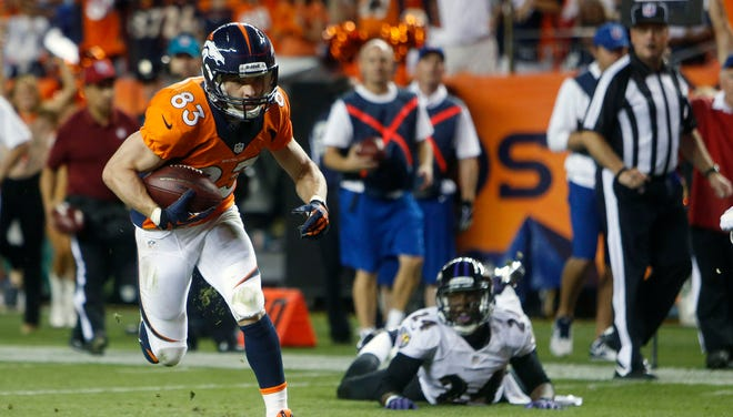 Denver Broncos wide receiver Wes Welker (83) scores a touchdown during the second half against the Baltimore Ravens at Sports Authority Field at Mile High.
