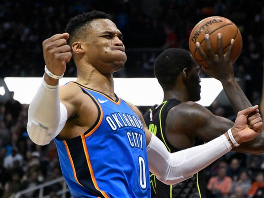 Oklahoma City Thunder guard Russell Westbrook reacts after being fouled during the second half of an NBA basketball game, Tuesday, March 13, 2018, in Atlanta. Oklahoma City won 119-107. (AP Photo/John Amis)
