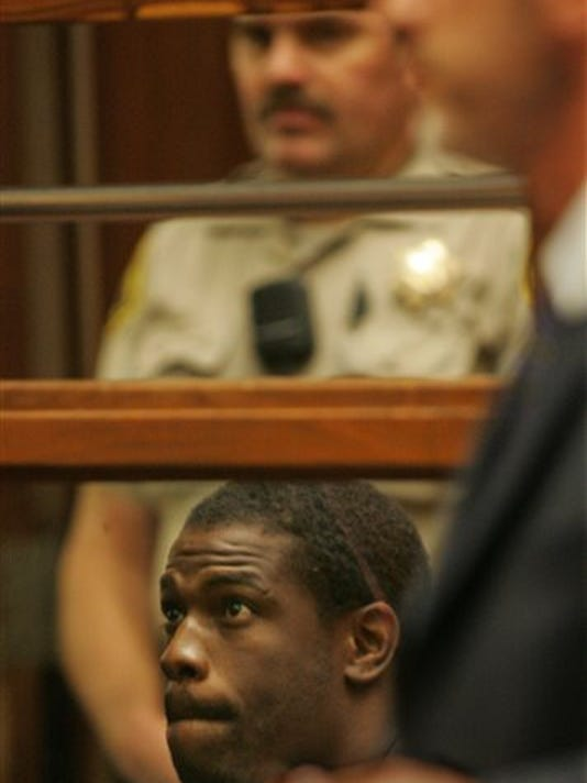 In this June 2, 2005, file photo, former NFL running back Lawrence Phillips is arraigned in Superior Court in Los Angeles. Phillips has been charged with murder in the death of his cellmate at a Central California prison.