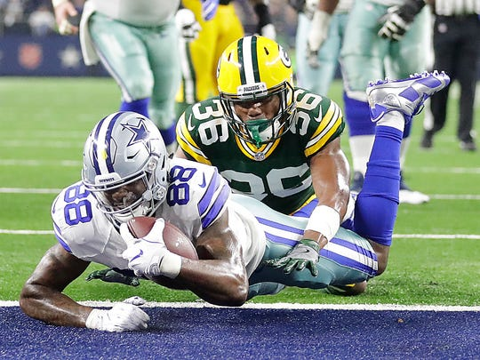 Green Bay Packers cornerback LaDarius Gunter (36) gives up a touchdown to wide receiver Dez Bryant (88) against the Dallas Cowboys at AT&T Stadium in Arlington, TX Sunday, January 15, 2017.
