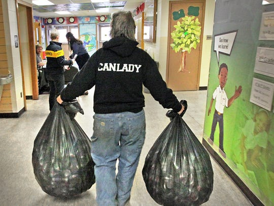 The Can Lady, Mary Stumpp, is shown on the job at IPS School 2, on her regular collection route to local inner city schools, where she collects aluminum cans and metal that has been collected by students taking part in a school projects to get needed items for their schools.