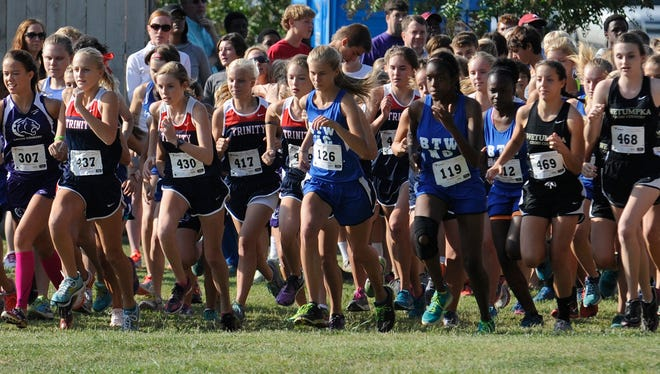 Runners compete in the Montgomery Academy Cross Country Invitational meet on Saturday September 26,  2014 at Gateway Park in Montgomery, Ala.