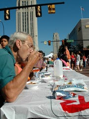 Keith Shellenberger of Battle Creek enjoys his cereal at the World's Longest Breakfast Table during the 2008 Cereal City Festival.