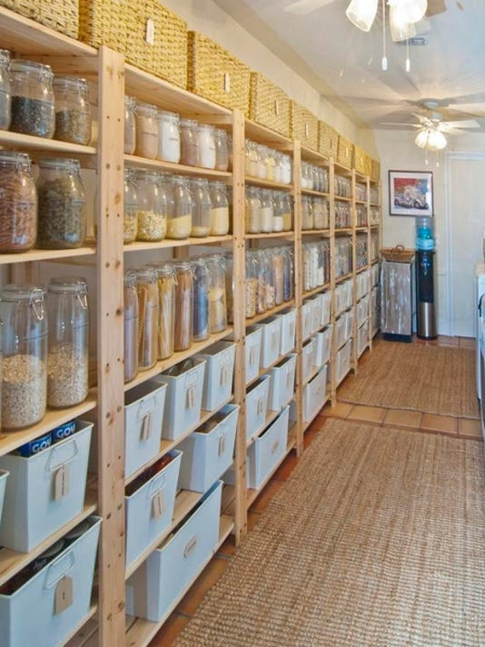 The pantry/laundry room shelves are lined with 146 clear glass jars filled with staples. Twelve wicker baskets hold paper and