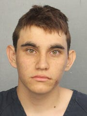 This photo provided by the Broward County (Fla.) Sheriff's Office on shows Parkland, Florida high school shooting suspect Nikolas Jacob Cruz, in a jail booking photo.