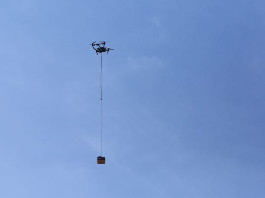 A drone delivers an Amazon box before Westchester officials