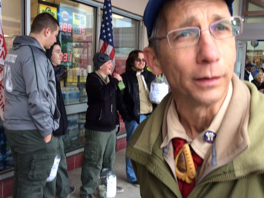 Joe McCoy Sr., right, one of the leaders of Boy Scout Troop 97, speaks about the things Paul DeSarno has done for the troup while scouts collect donations for the DeSarno/Klitzke family Saturday at the ShopRite in Sayreville.