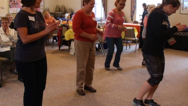 Katie Nelson from Inspira Health Network's Fitness Connection leads a Zumba Gold class during a health fair at the Millville Woman's Club. Members (from left) Claudia Rempfer, Louise Jones and Sharon Mosley join in the class.