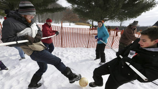 Tanner Rogers (left) and Jacob Tews battle in a Human Foosball game during Winter Family Fun Day at Mosquito Hill Nature Center in New London.