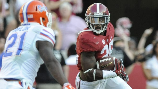 MICKEY WELSH/ADVERTISER FILE Alabama defensive back Landon Collins (shown against Florida) intercepted a pass to seal the game against Arkansas. Alabama defensive back Landon Collins (26) returns an interception against Florida at Bryant Denny Stadium in Tuscaloosa, Ala. on Saturday September 20,  2014.