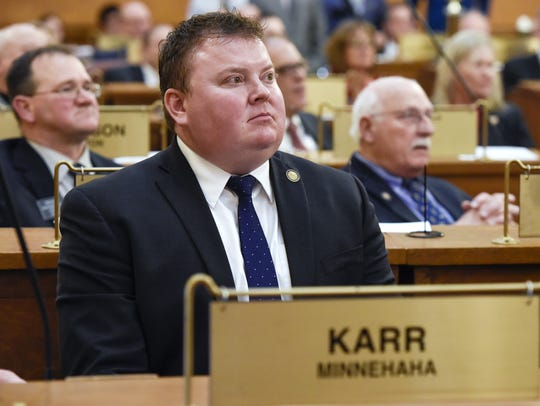 Rep. Chris Karr (R-Sioux Falls) sits at his desk in