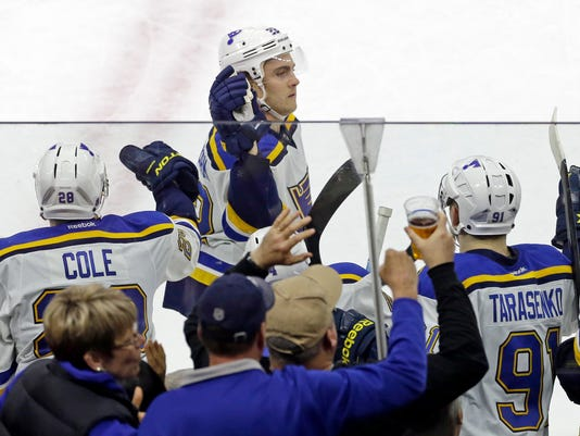 St. Louis Blues' Kevin Shattenkirk is congratulated by team-mates following his goal against the Carolina Hurricanes in the shootout during an NHL hockey game in Raleigh, N.C., Friday, Jan. 30, 2015. St. Louis won 3-2. (AP Photo/Gerry Broome)