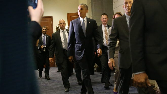 President Barack Obama departs from a meeting with House Democrats on Capitol Hill June 12, 2015 in Washington, DC. President Obama urged members of Congress to pass his trade agenda.