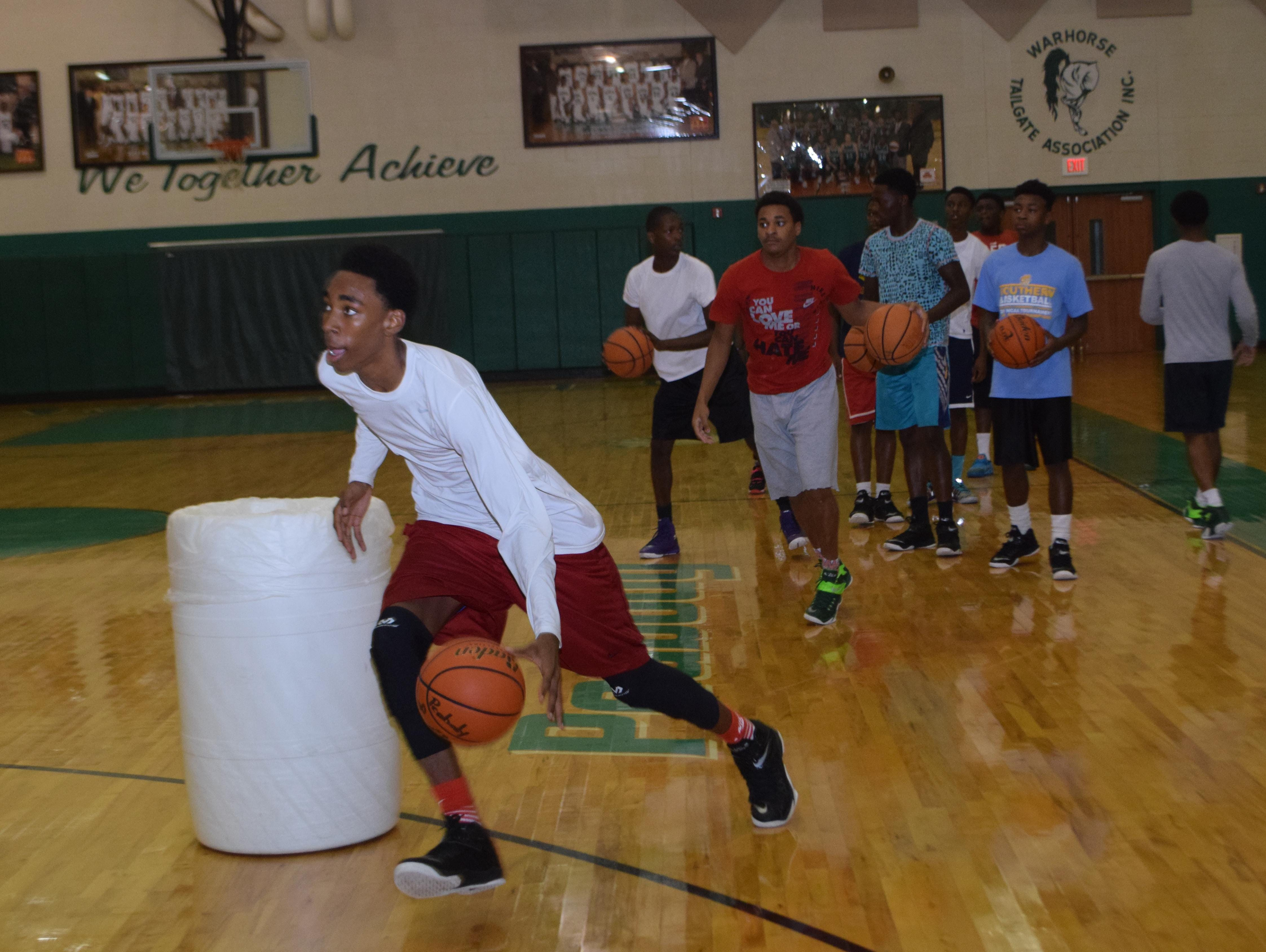 Peabody's Kamron Trowel practices with the rest of the Peabody team Wednesday. The Peabody Magnet High School basketball team recently won the Houston National Summer Showcase.