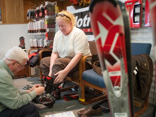 Danzeisen & Quigley sales associate Tim Gleeson fits Cori Hess of Haddonfield for a pair of ski boots in a 2015 file photo.