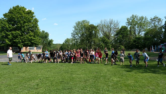 Members of the Junior Spartan Running Team lineup to run.