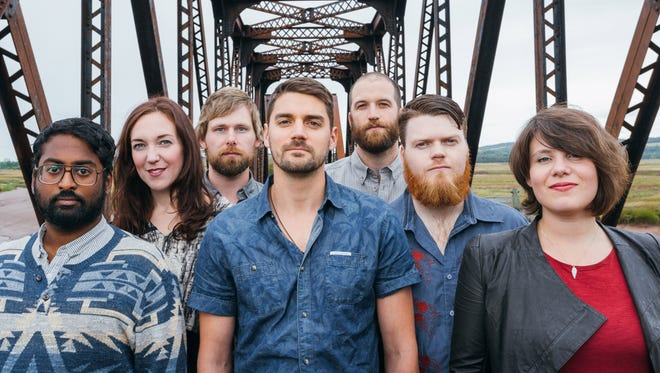 Tim Baker, center, leads Canadian indie-rock band Hey Rosetta!