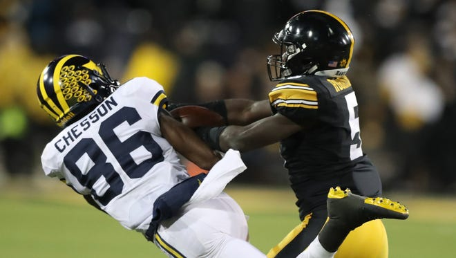 Michigan's Jehu Chesson looses a pass to Iowa's Manny Rugamba during the second half of U-M's 14-13 loss Saturday in Iowa City, Iowa.