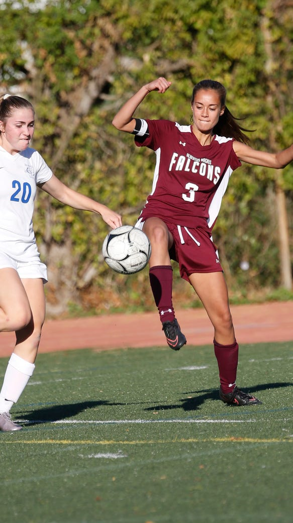 Bronxville's Isabel Sandey (20) and Magnus' Danielle